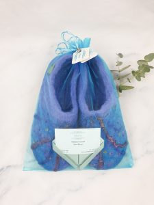packaged purple felt slippers